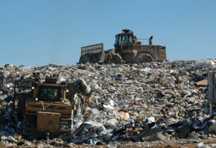 Bulldozing trash at a landfill